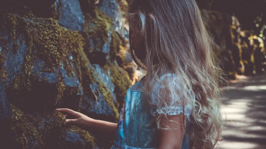 Beltane Arts and Crafts Photo - Young Girl looking at mossy rocks