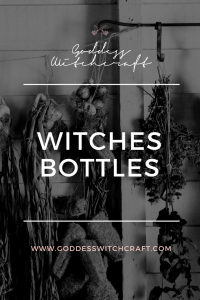 Witches Bottle Pinterest Image - Herbs hanging on a drying rack